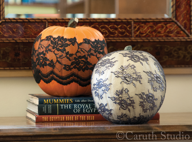white and orange pumpkin wrapped in lace
