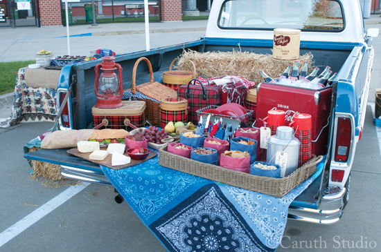 1970 Ford pickup in Blue and White, with a lavish picnic setup on the tailgate