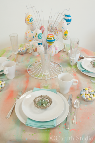 Champagne flutes on watercolor tablecloth