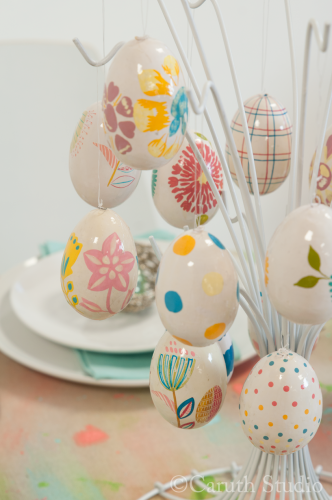Painted Easter eggs on repurposed jewelry hanger