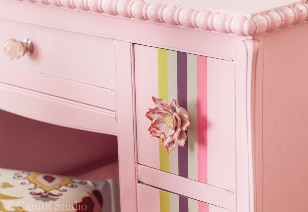 Flower knobs on painted desk