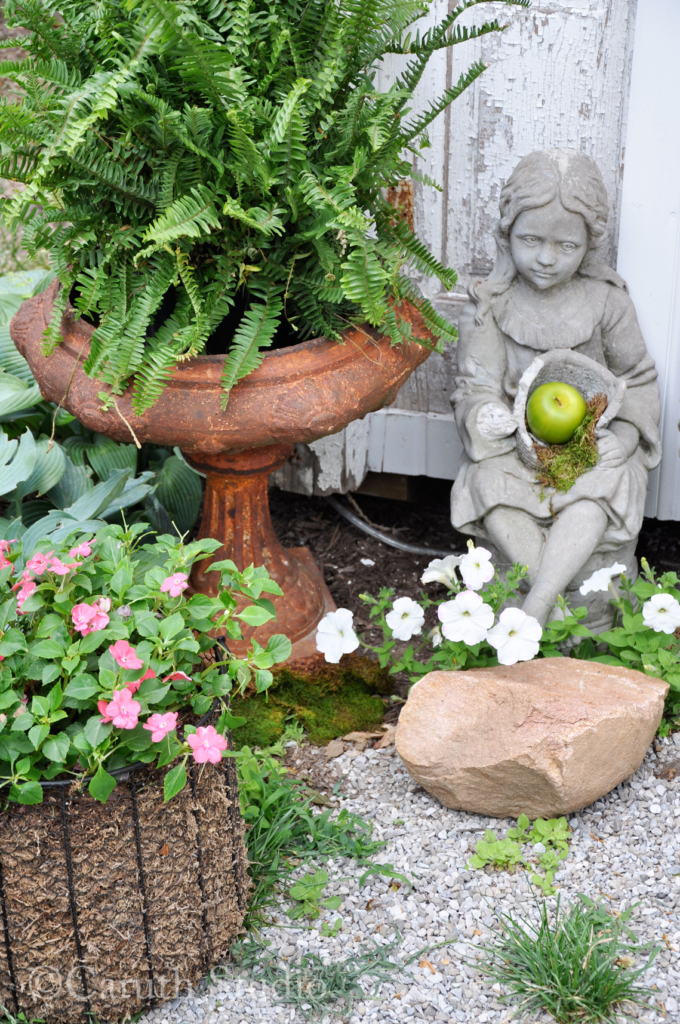 Vintage containers and garden statue