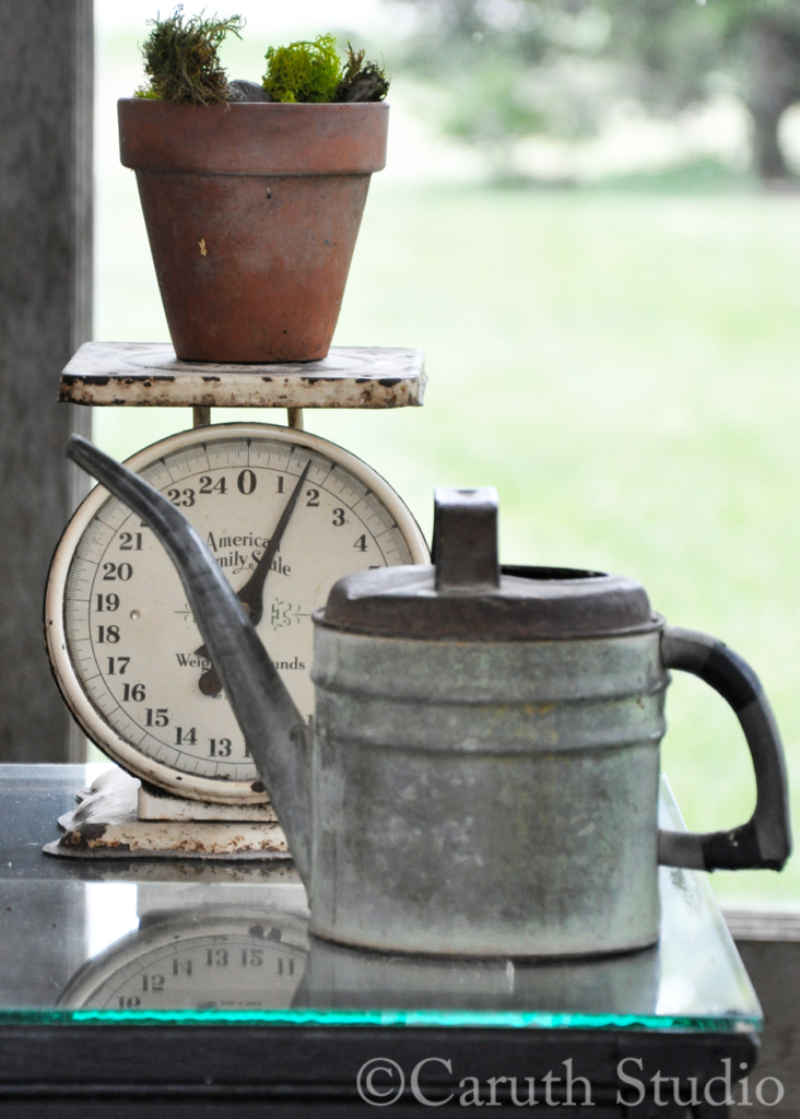 Vintage scale and watering can