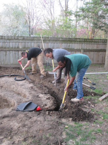 The-crew-digs-the-wiring-trench