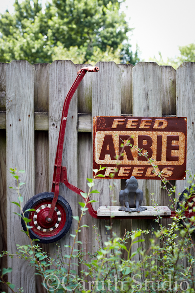 Vintage scooter and metal sign on fence