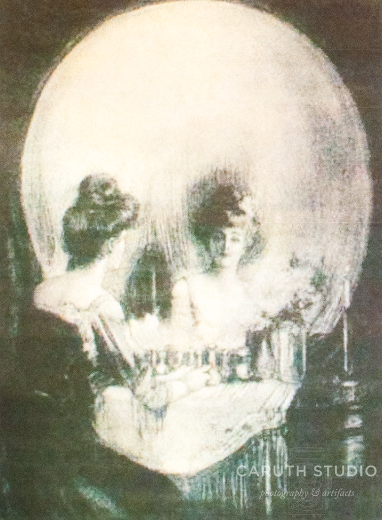 All is Vanity print that looks like a skull but is in fact a woman at a vanity