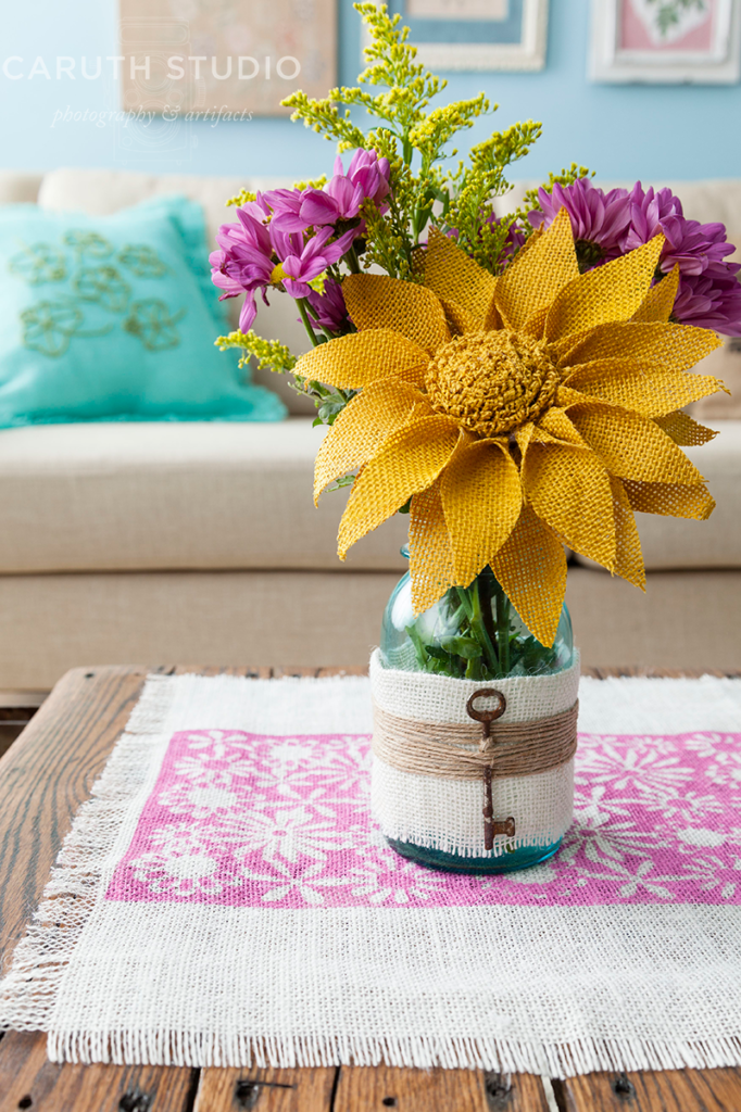 Burlap wrapped jar with key accent and yellow and pink flowers