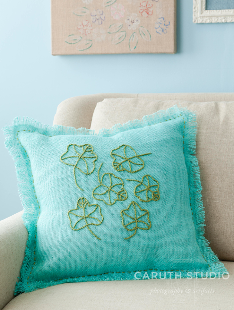 green leaves embroidered on aqua burlap pillow