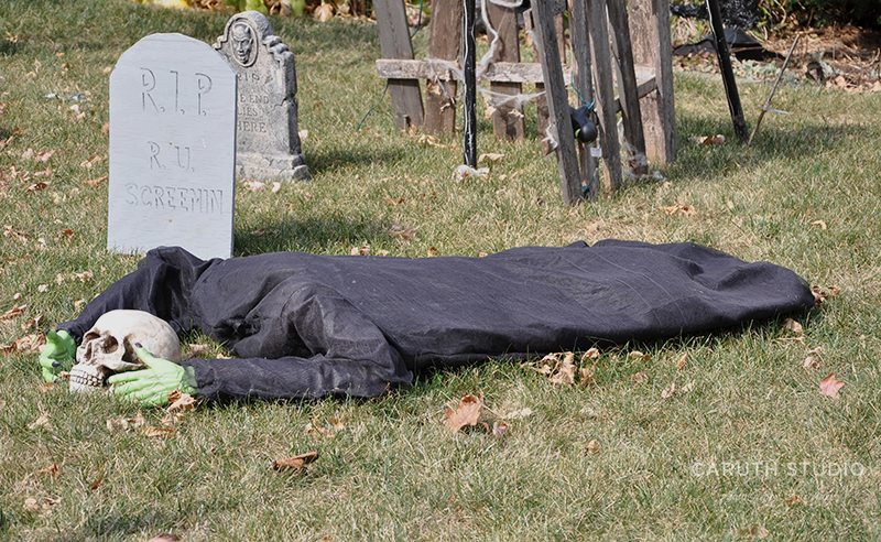 Headless ghoul laying in the graveyard