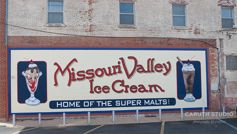Missouuri Valley Ice cream sign with red lettering, blue banner that says Home of thSuper Malts with an image of an ice cream sunday