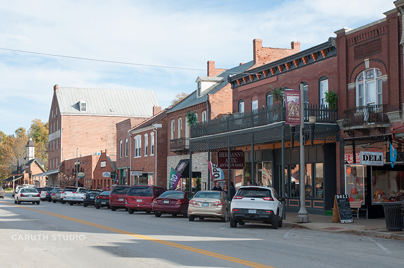 Main street view of Hermann with two story connect shop buildings built in brick