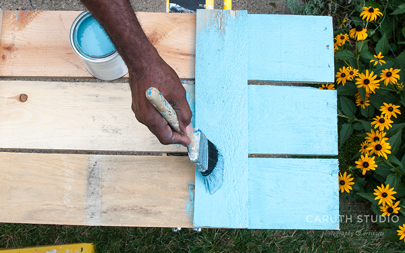 Painting wooden shutters with teal paint