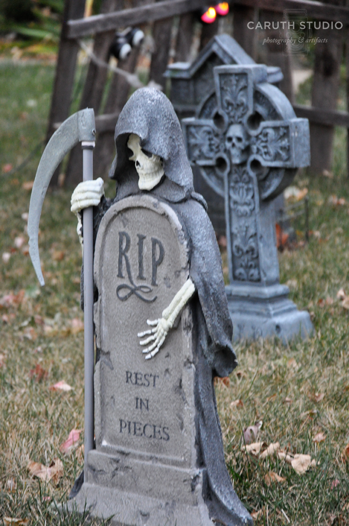 Reaper looming over tombstone which reads RIP Rest in Pieces