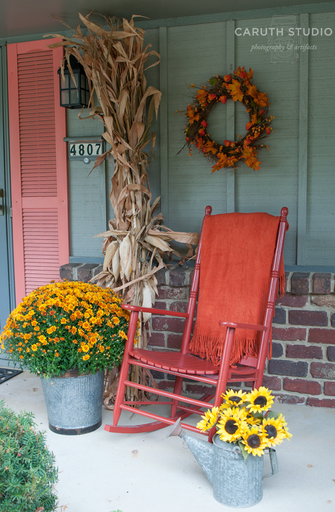 Rocker and fall wreath with flowering mums and dried corn stalks