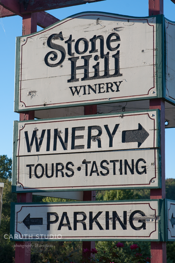 Stone Hill Winery sign with black text on white sign