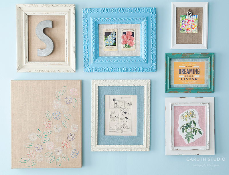 Wall art grouping made of wooden frames, paper and burlap