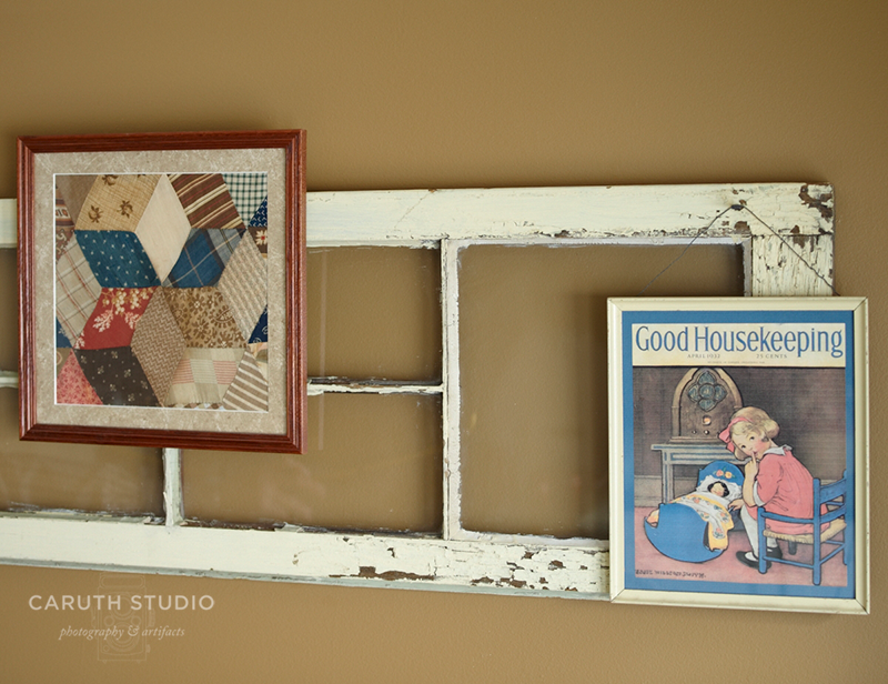 Vintage wall grouping made of an old door and framed quilt square and Good Housekeeping image