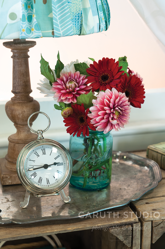 Clock and flowers in mason jar