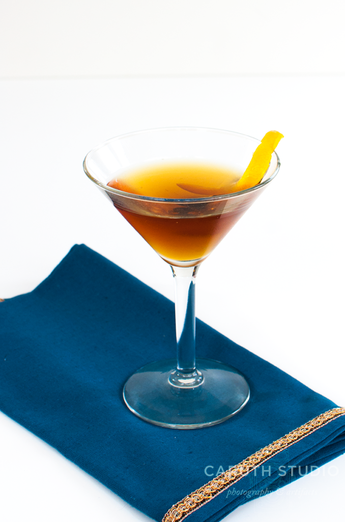 Hanky Panky cocktail on royal blue and gold napkin