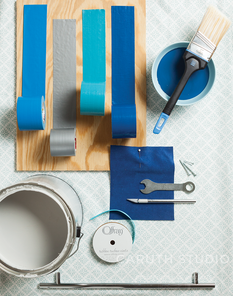 Blue mood board with paint duct tape cloth and wood