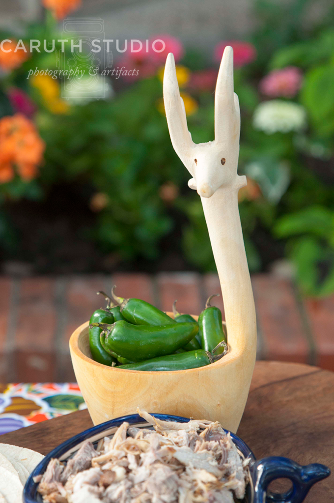 Stylized deer bowl with long neck filled with fresh jalapenos