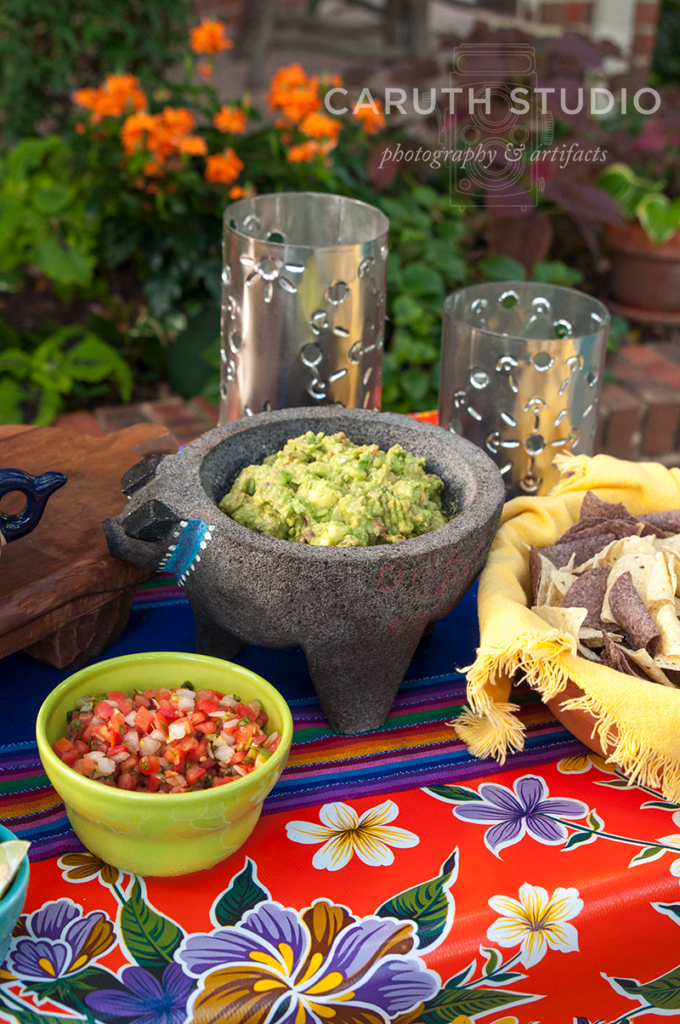 Fiesta chips and dips with guacamole in a lava bowl