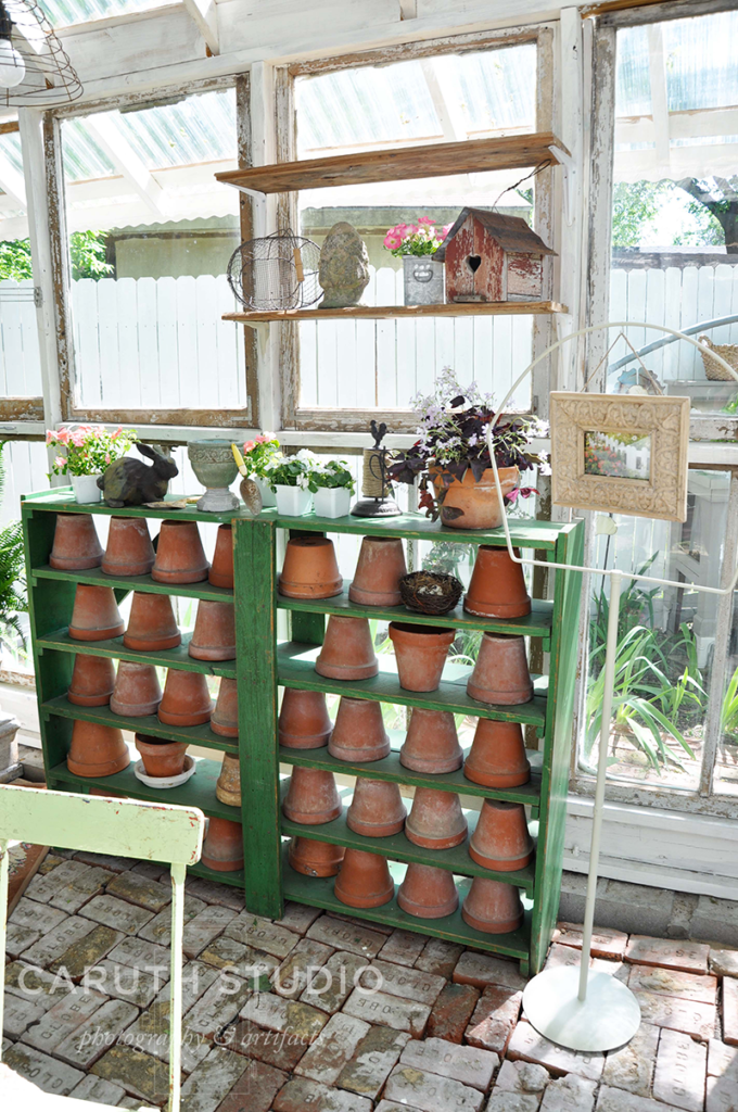 Green shelves with terracotta pots