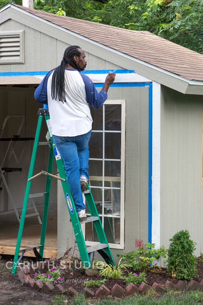 Narvas paints the shed trim