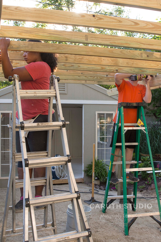 Screwing beams in place on the pergola