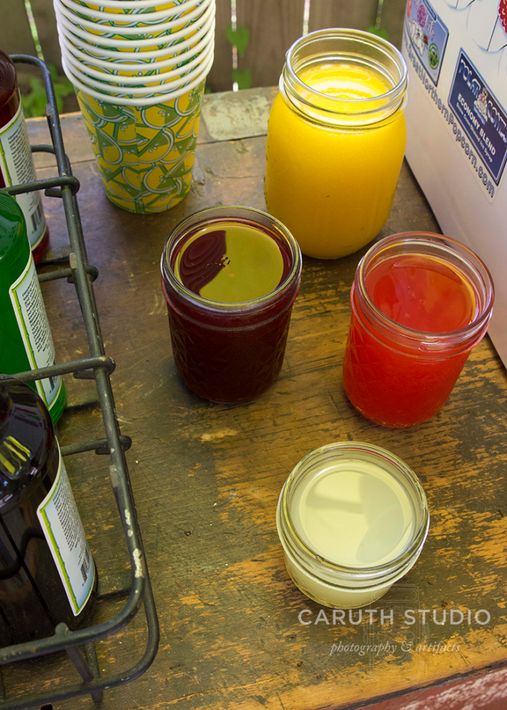 jars of homemade fruity adult syrups