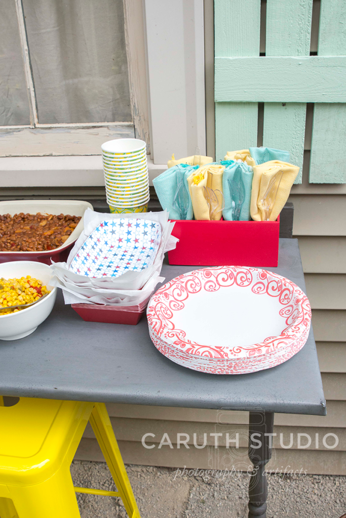 summer patio party plates, napikins and plastic eating utensils