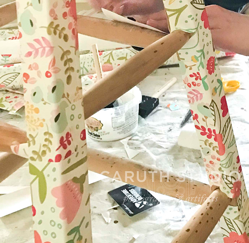 in the process of creating a Decoupaged stool