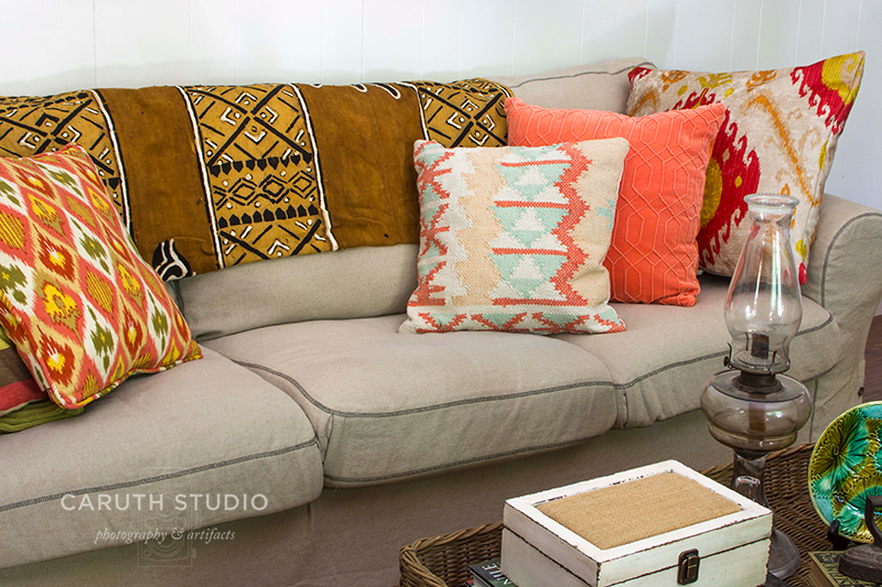 couch with pillows and blanket with coffee table