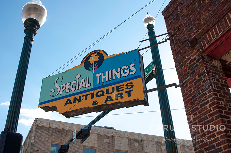 Special Things antiques and art sign on an old brick building