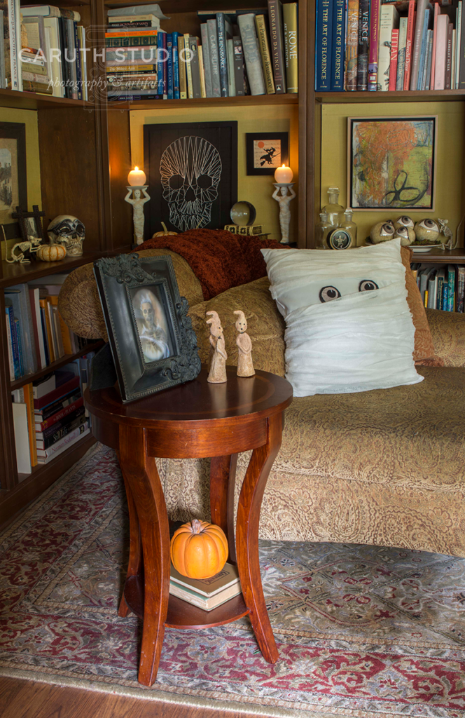 over all of the spooky library setting with ghosts, pumpkins, a mummy pillow and decorated bookcases