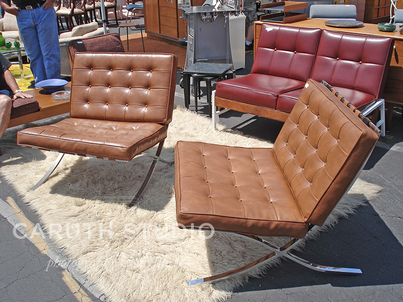 a pair of Midcentury modern chairs in brown leather