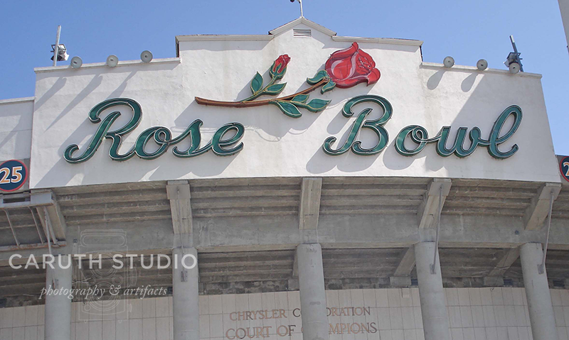 Rose Bowl stadium with red rose graphic above lettering