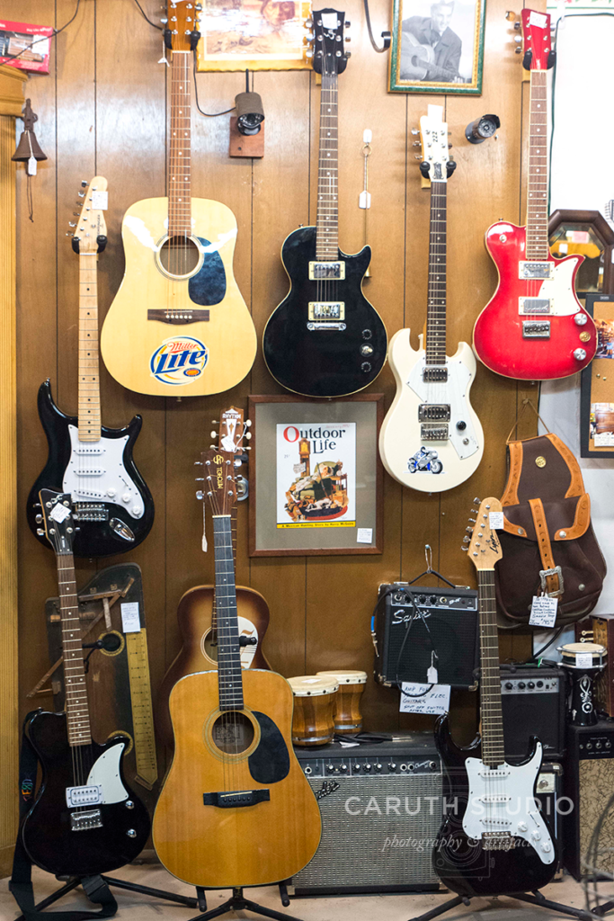 guitar display in a shop window