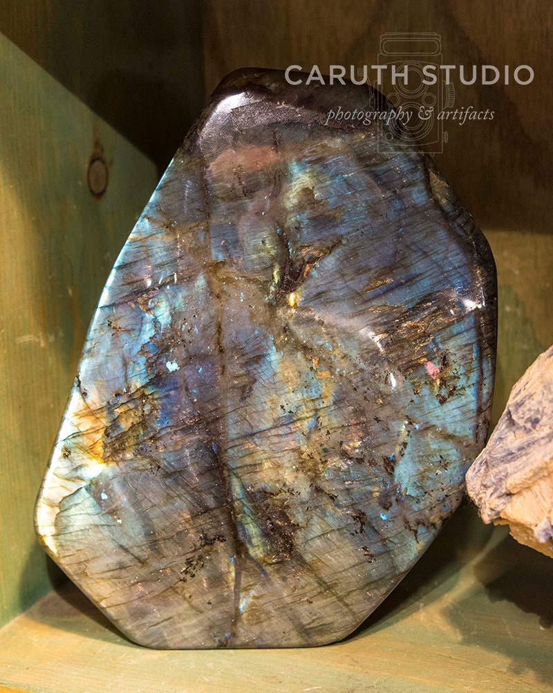 closeup of the many colors in labradorite polished rock