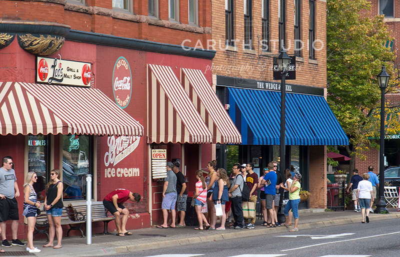 a line up to the ice cream window at the ice cream and burger shop