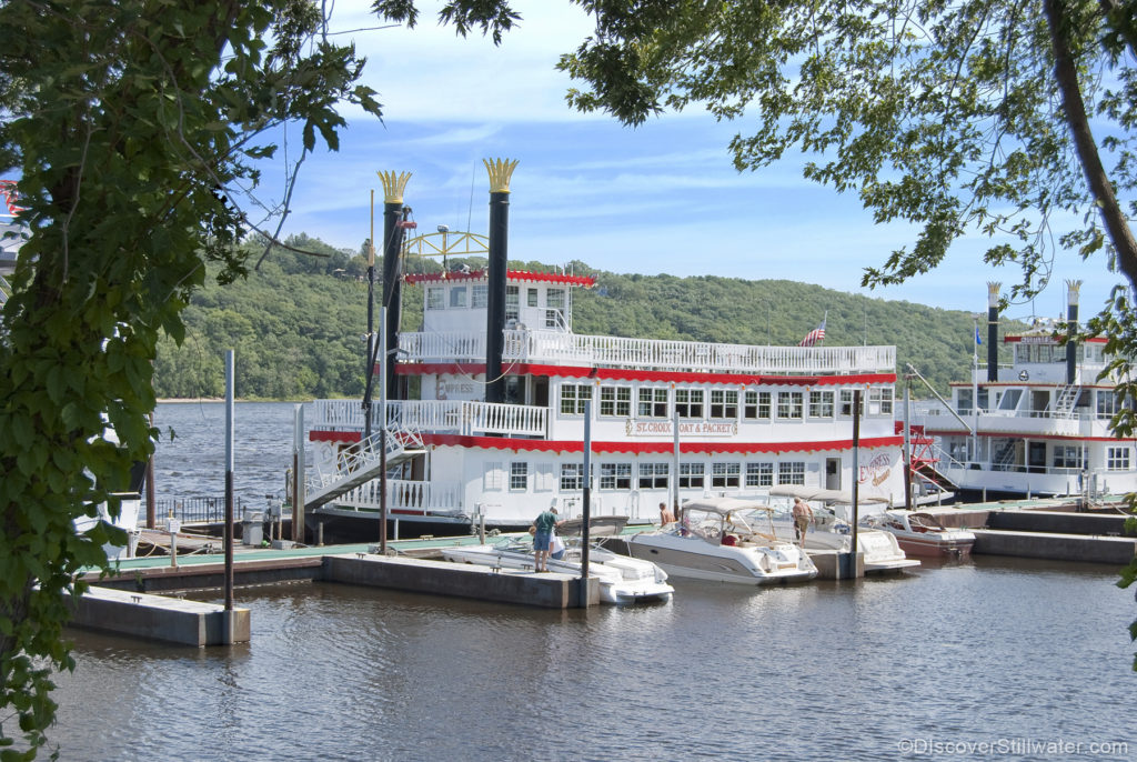 Paddlewheel boat in the river with two smoke stakes and three decks