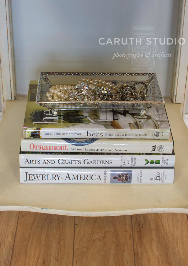 jewelry bowl on top of a stack of three books