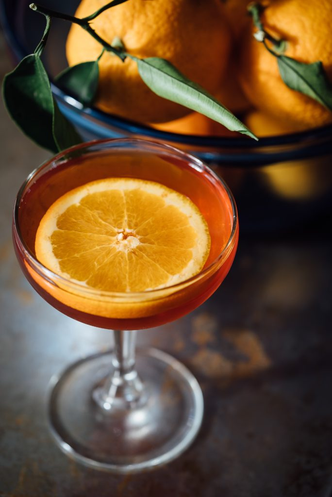 orange cocktail in coup glass