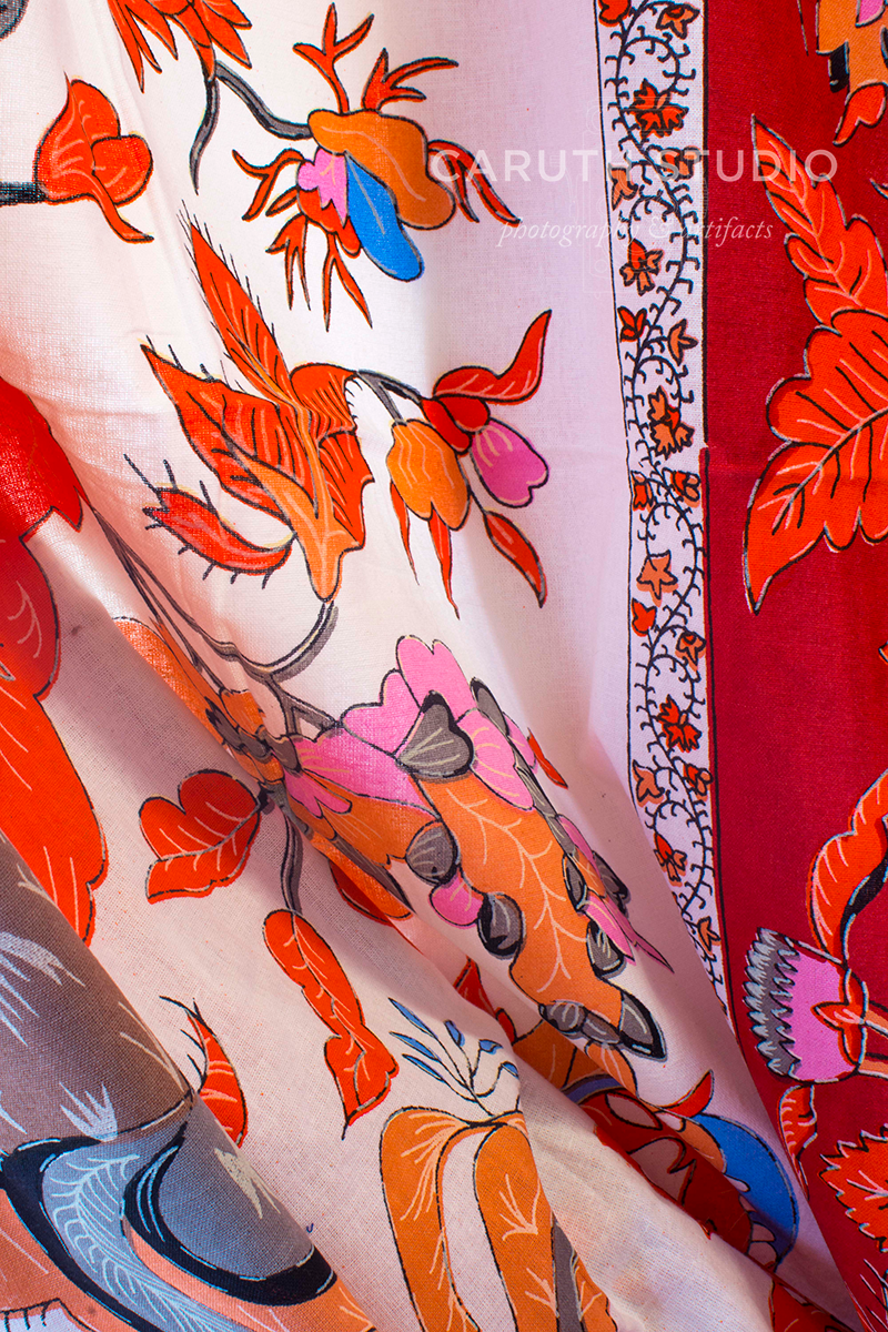 red, white, blue and orange textile with floral designs