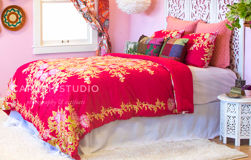 Boho bedroom all dressed up in jewel tones and pinks