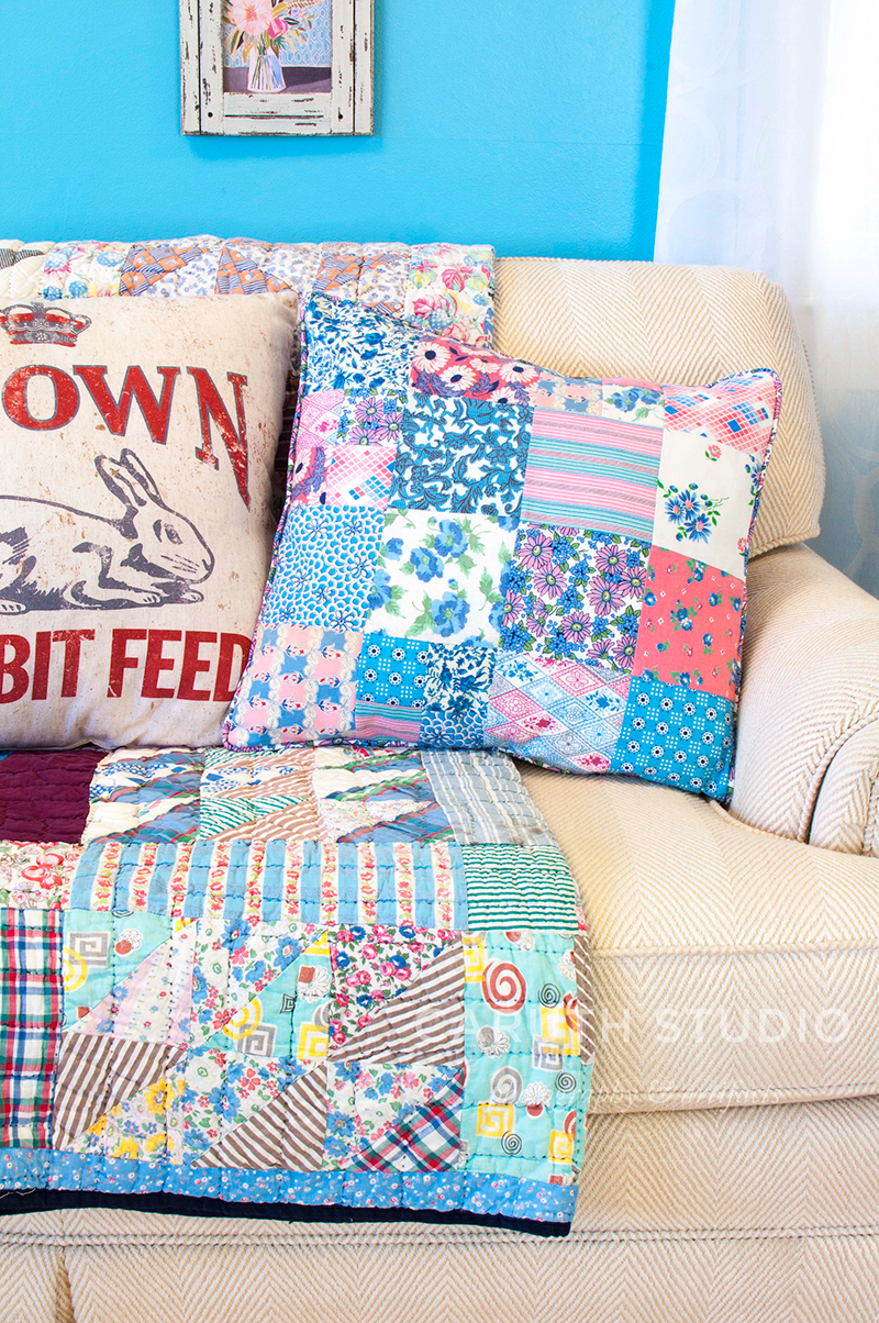 blue patchwork pillow and throw on cream couch