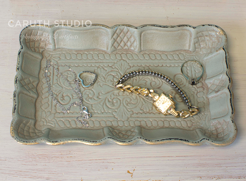 Cottage Nightstand Jewelry Tray with a ring, watch and necklace in it