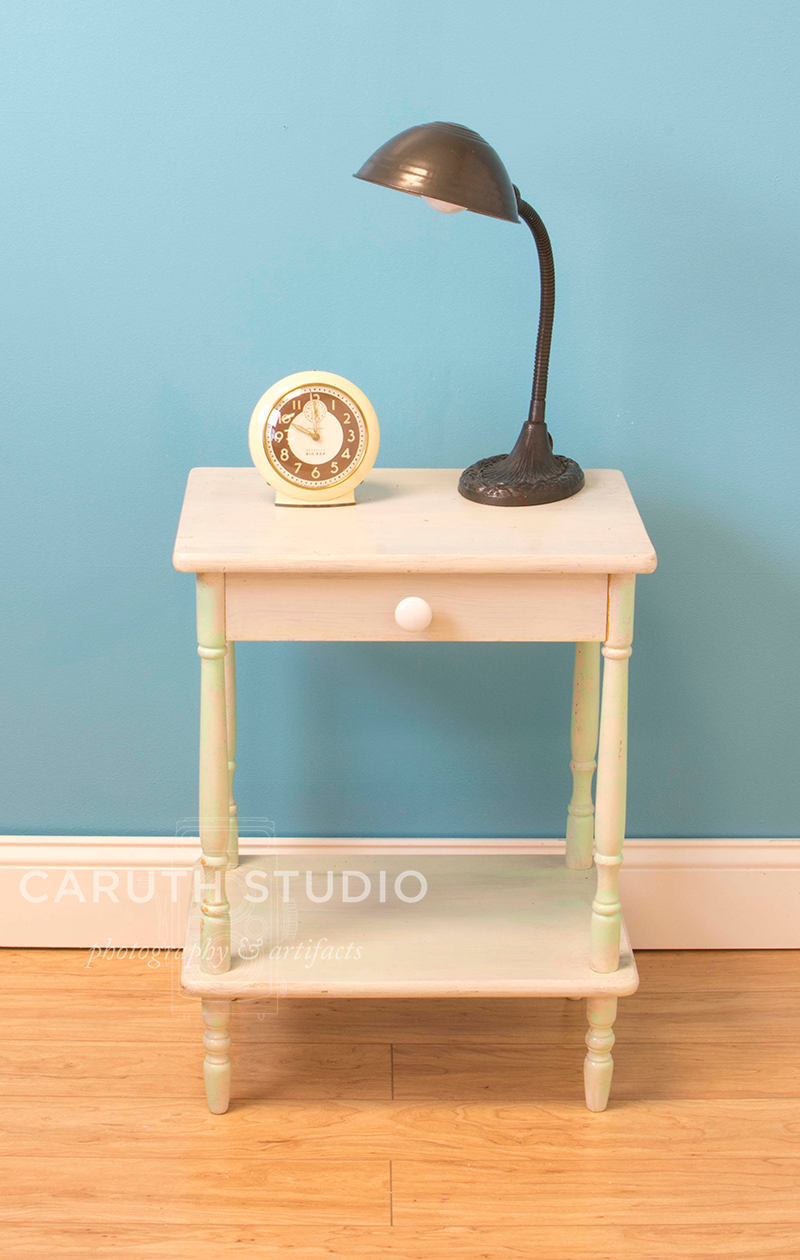 nightstand with lamp and clock