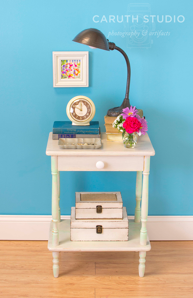 floral watercolor hung over the decorated cottage style nightstand