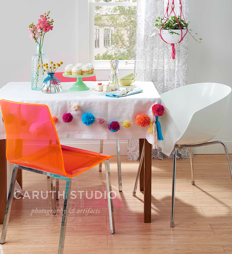 Dining table with pom-pom garland detail